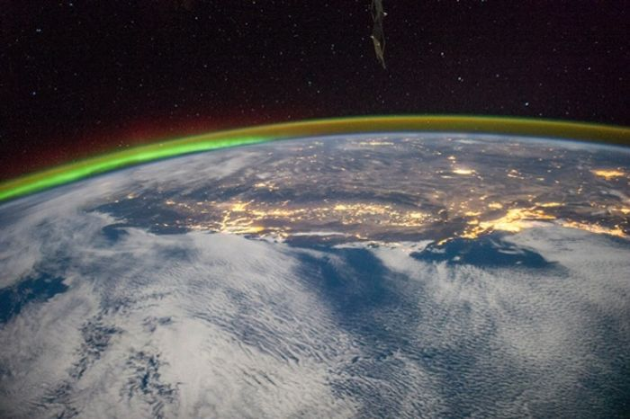 Night over Los Angeles, the Central Valley, and the Sierra Nevada, and Salt Lake City with a green aurora (left) on the horizon