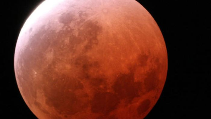 A Lunar Eclipse gives the moon a red tint.