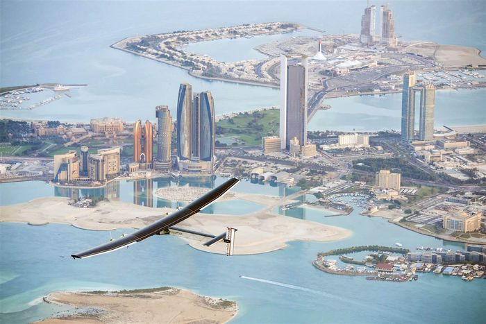 The Solar Impulse 2 flies over Abu Dhabi on a test flight on Feb. 26. The solar-powered plane has a wingspan of 236 feet, larger than that of a Boeing 747, but weighs only 4600 pounds, about as much as a family car. More than 17,000 solar cells on the wing power lithium-ion batteries in four electric motors. The airframe makes use of carbon fiber, which is three times lighter than paper, to keep the plane as light as possible.