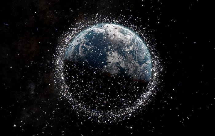 An artist's illustration of the space junk orbiting the Earth today (not to scale).