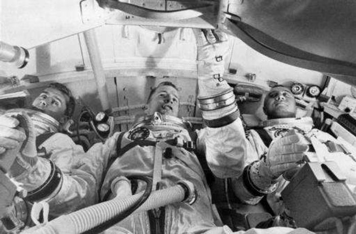 NASA astronauts from left, astronauts Roger Chaffee, Edward White II, and Virgil Grissom, practice for launch inside the Apollo 1 capsule.