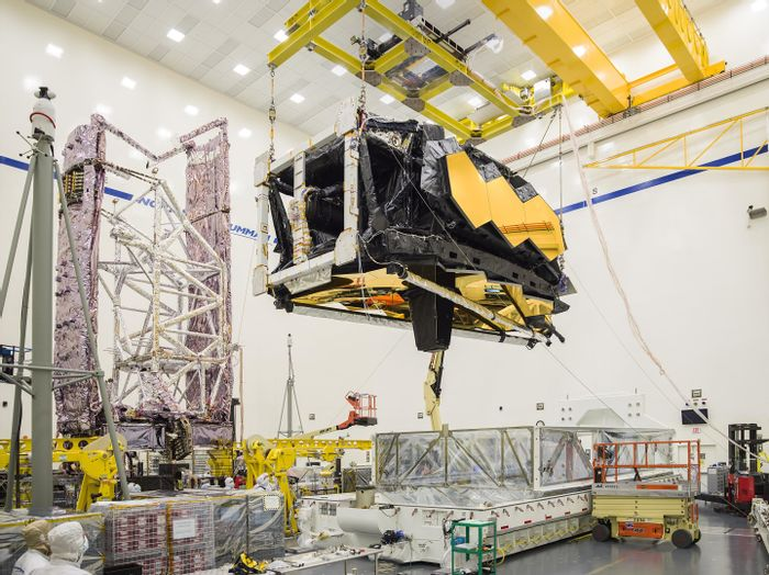Engineers hoist the heart of the James Webb Space Telescope out of its shipping container at its final testing facility in California.