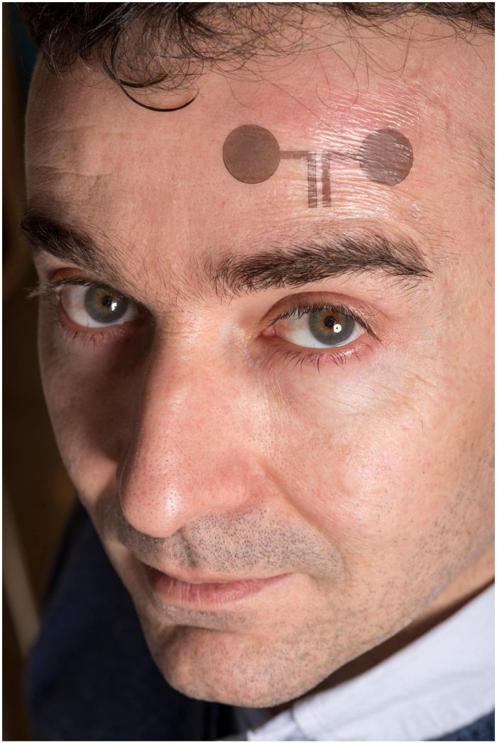 Francesco Greco with a temporary tattoo electrode. Credit: Lunghammer - TU Graz