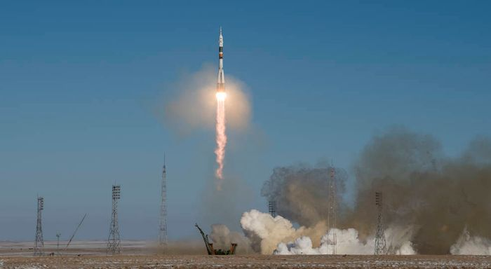A Russian Soyuz spacecraft launches from the Baikonur Cosmodrome on Sunday, carrying three new crew members for the International Space Station.
