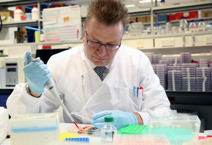 Professor Sewell at work in the lab. / Credit: Cardiff University