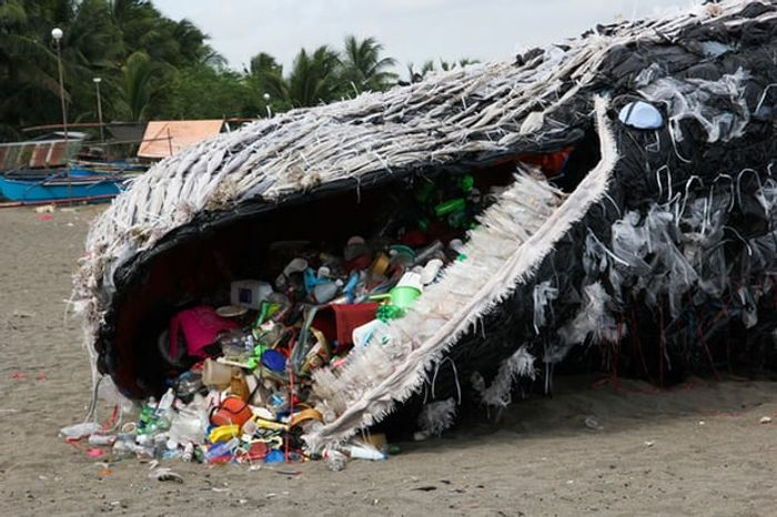 Greenpeace model of a whale dead from plastic.  Photo: Greenpeace