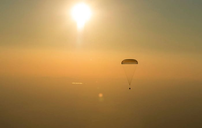 The Soyuz spacecraft begins its descent back to Earth.