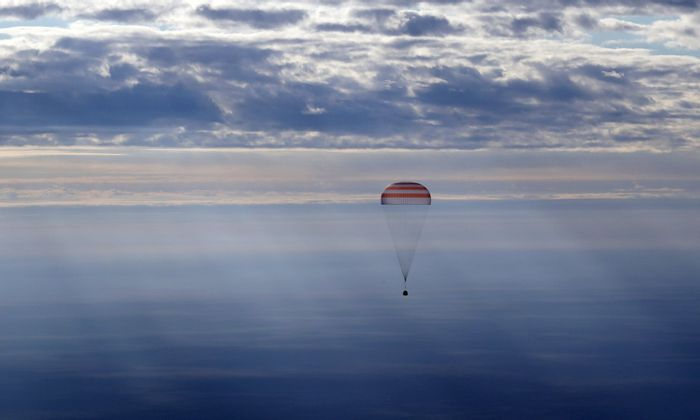 An upgraded Soyuz spacecraft carrying three ISS astronauts lands back on Earth safely.