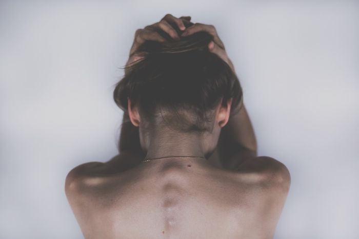 Person in pain, public domain
