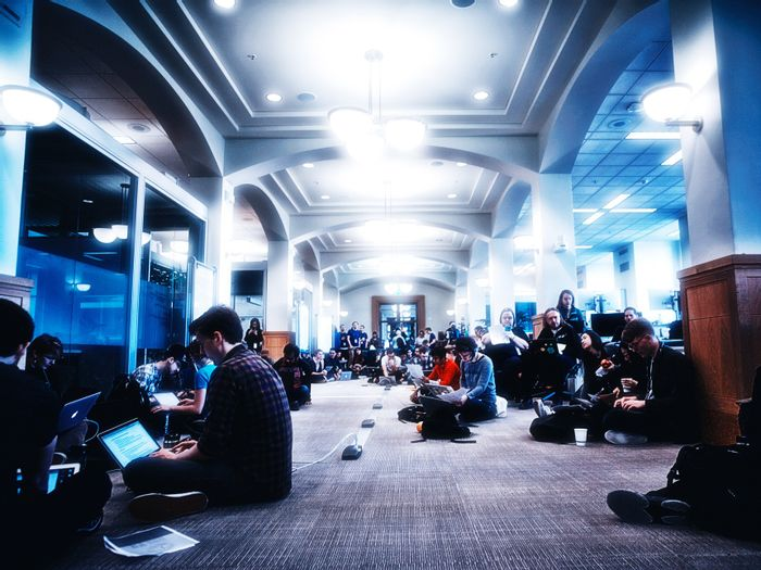 Coders gather to archive climate data. Photo: Wired