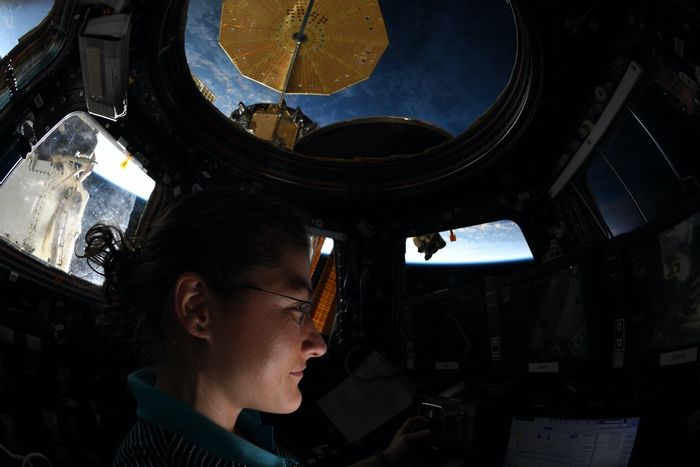 NASA astronaut Christina Koch stares out of the International Space Station's Cupola window.