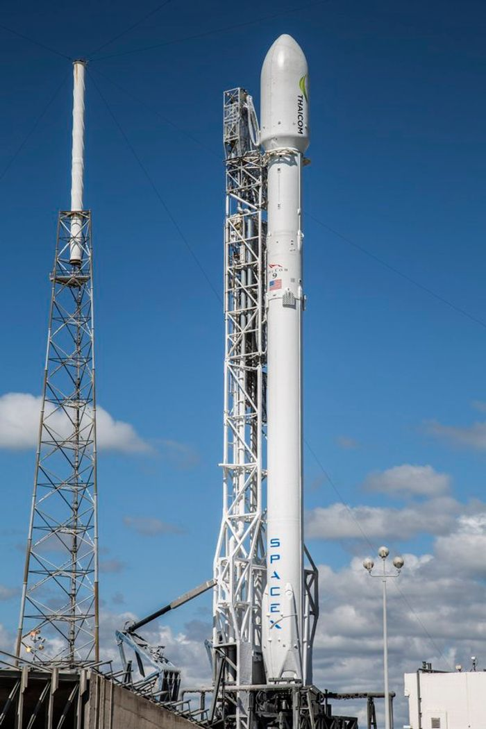 SpaceX will try to launch another telecommunications satellite into space on Friday, then attempt a landing of the Falcon 9 rocket once again.