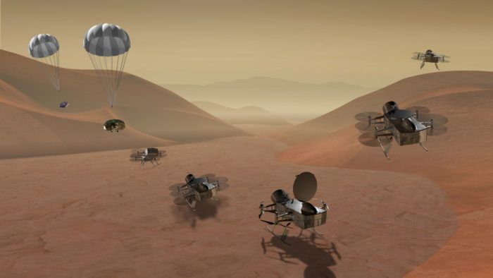 An artist's impression of the Dragonfly quadcopter vehicle as it descends from Titan's atmosphere.