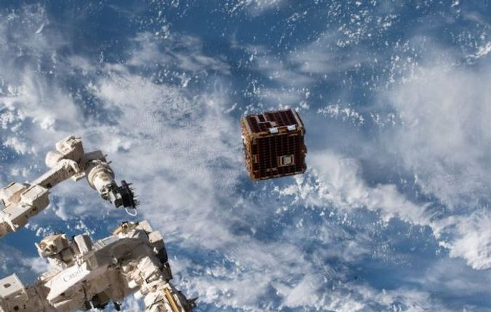The RemoveDebris spacecraft being deployed from the International Space Station.
