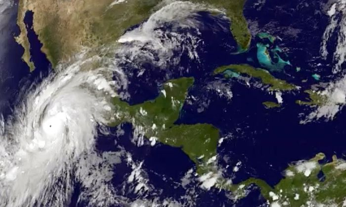A satellite image showing Hurricane Paricia moving over Mexico's Pacific Coast.