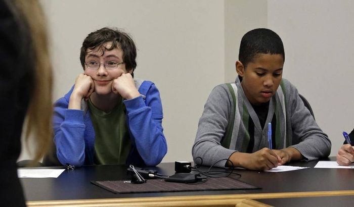 Petitioners Gabe Mandell, 14, left, and Adonis Williams, 12, look on as an attorney speaks at a court hearing Tuesday, Nov. 22, 2016, in Seattle. Elaine Thompson AP
