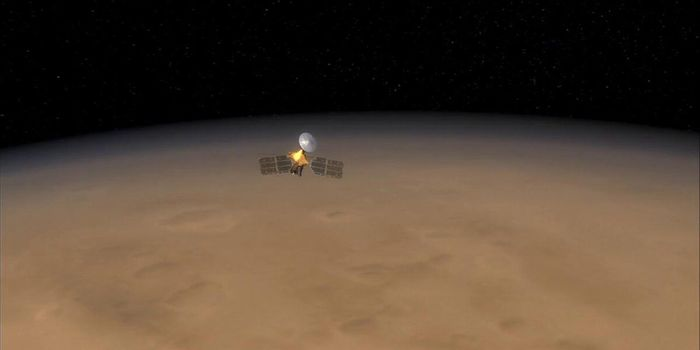 An artist's illustration of the MRO orbiting Mars.