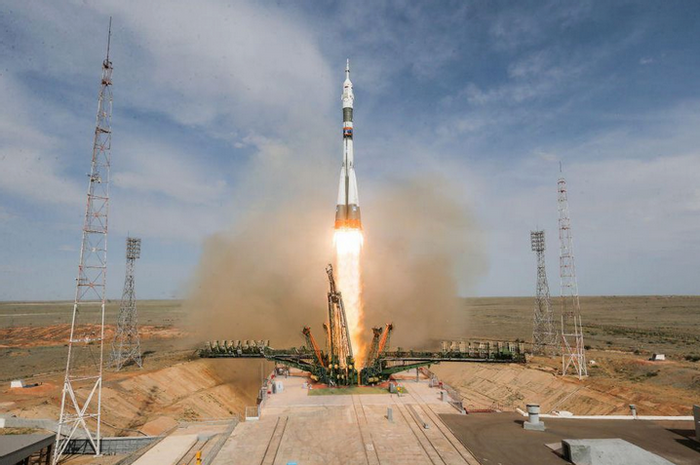 An image of a Soyuz rocket blasting off from the Baikonur Cosmodrome.