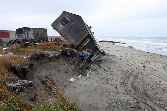 Shishmaref is literally eroding into the ocean. Photo: Yale E360