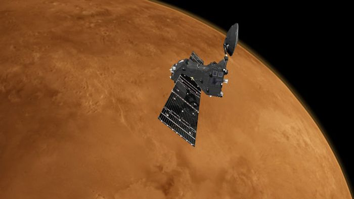 An artist's impression of the ExoMars Trace Gas Orbiter orbiting Mars.