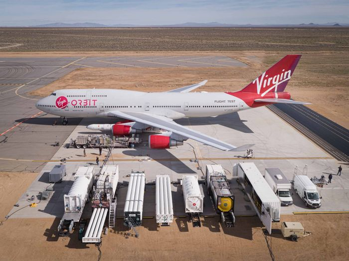 A Virgin Orbit 747 jet with its space rocket attached to the wing.