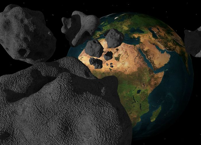 An artist's rendition of a hazardous asteroid breaking up before slamming into Earth.