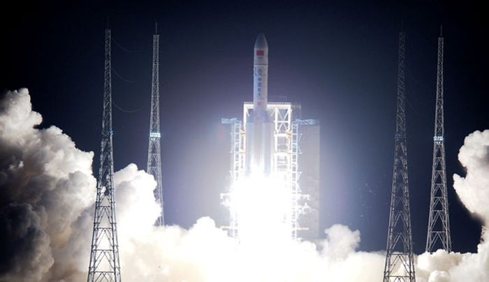 China's Long March 5 rocket lifts off from its launchpad.