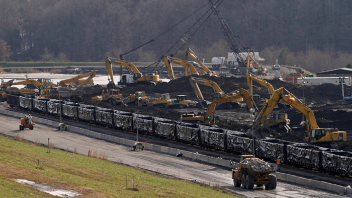 Coal ash from the Kingston Fossil Plant spill is loaded onto train cars. Four million tons of it was hauled to Uniontown, Alabama