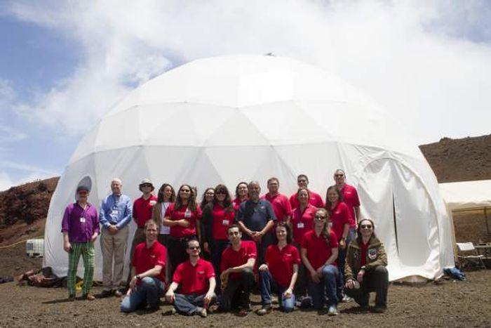 The team gathers in front of the dome on Mauna Loa. Photo: hawaiitribune-herald.com