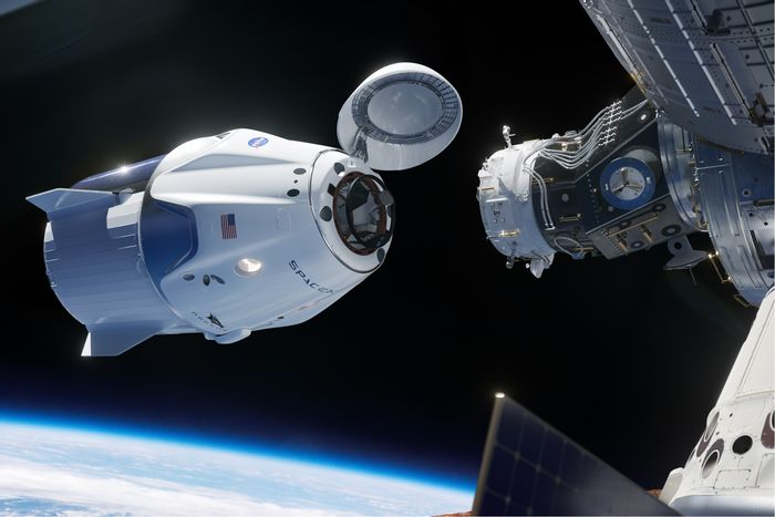 An artist's impression of the SpaceX Crew Dragon capsule approaching the International Space Station's docking region.