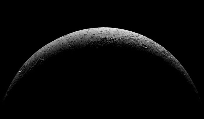 Is the surface of Dione hiding an ocean underneat like other moons orbiting Saturn?