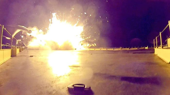 A SpaceX rocket comes to a crash landing on the drone ship at sea in 2015.