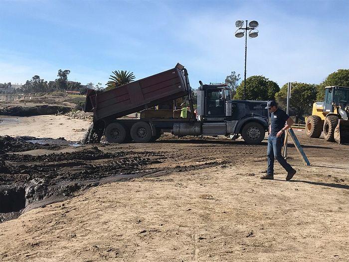 A truck dumps mud onto Goleta Beach. Photo: The Santa Barbara Independent