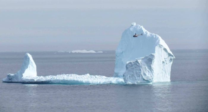 A helicopter flying by shows the impressive size of the iceberg. Photo: CBC