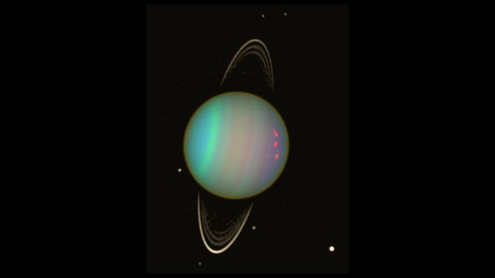 A false-color image of Uranus and its rings as captured by the Hubble Space Telescope.