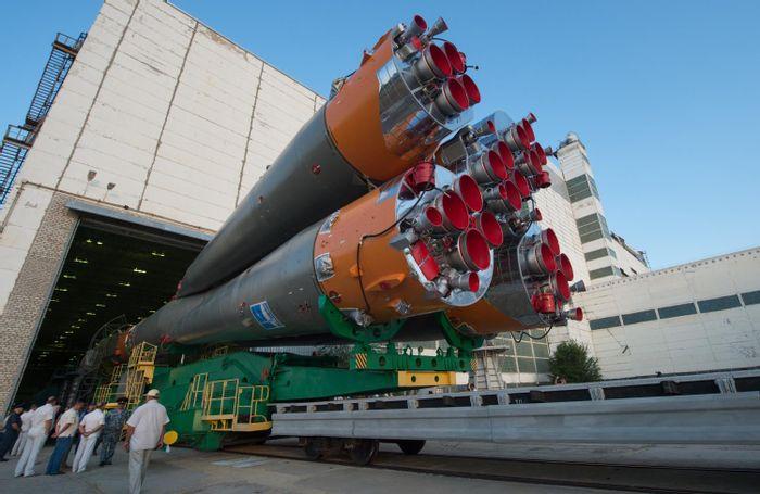 An image showing the Russian Soyuz rocket as it departs its hangar.