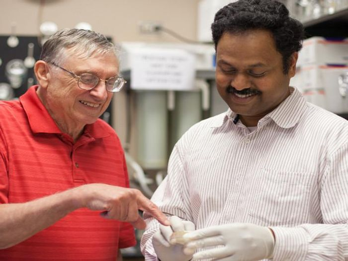 In the lab of George Fox, left, Madhan Tirumalai, right, is helping unravel the mysteries of space microbiology CREDIT University of Houston