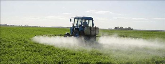 A tractor spray dicamba pesticides on crops. Photo: Farm Futures