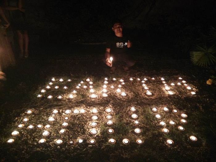 People celebrating Earth Hour in Myanmar with candles for light. Photo: Earth Hour