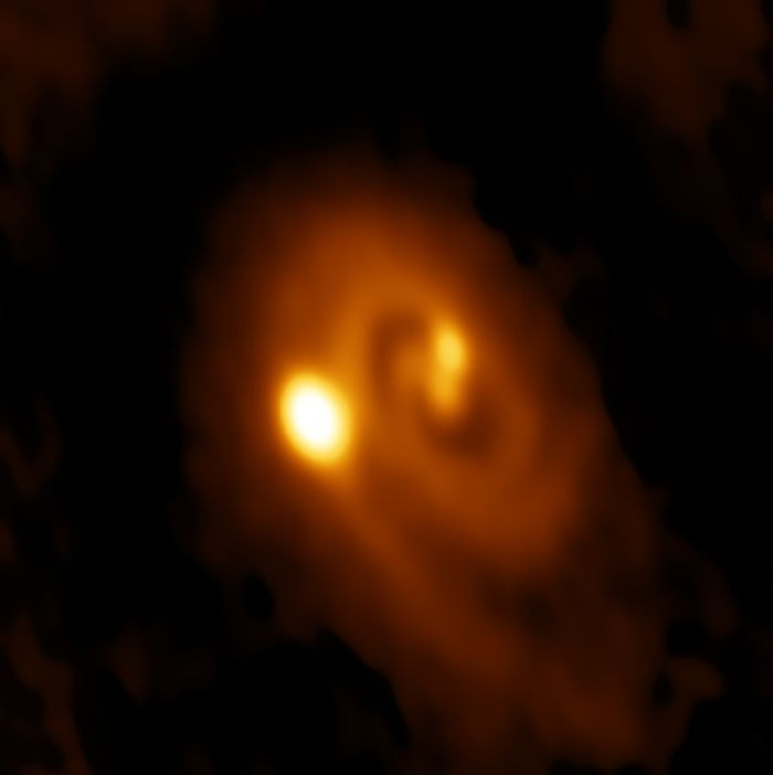 The triple star system in the middle of formation.