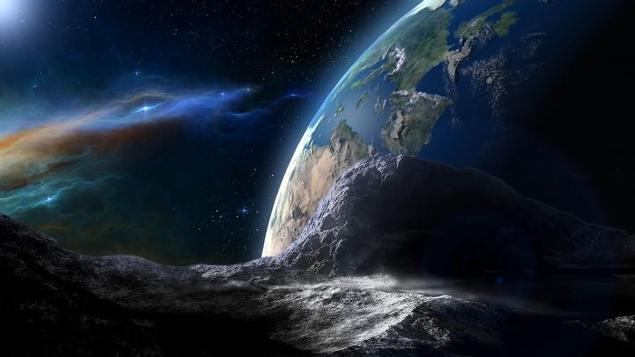 An artist's impression of a large asteroid passing by the Earth.