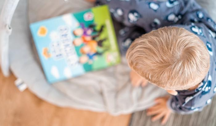 child reading, credit: public domain