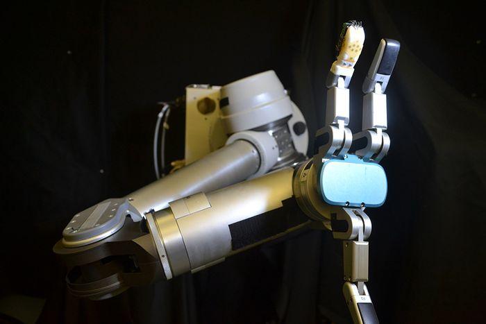 sensor skin on robotic arm, credit: UCLA Engineering