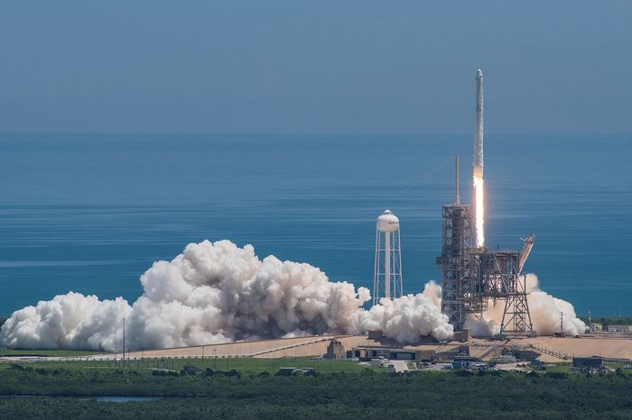 A SpaceX Falcon 9 takes off from an unrelated launch pad.